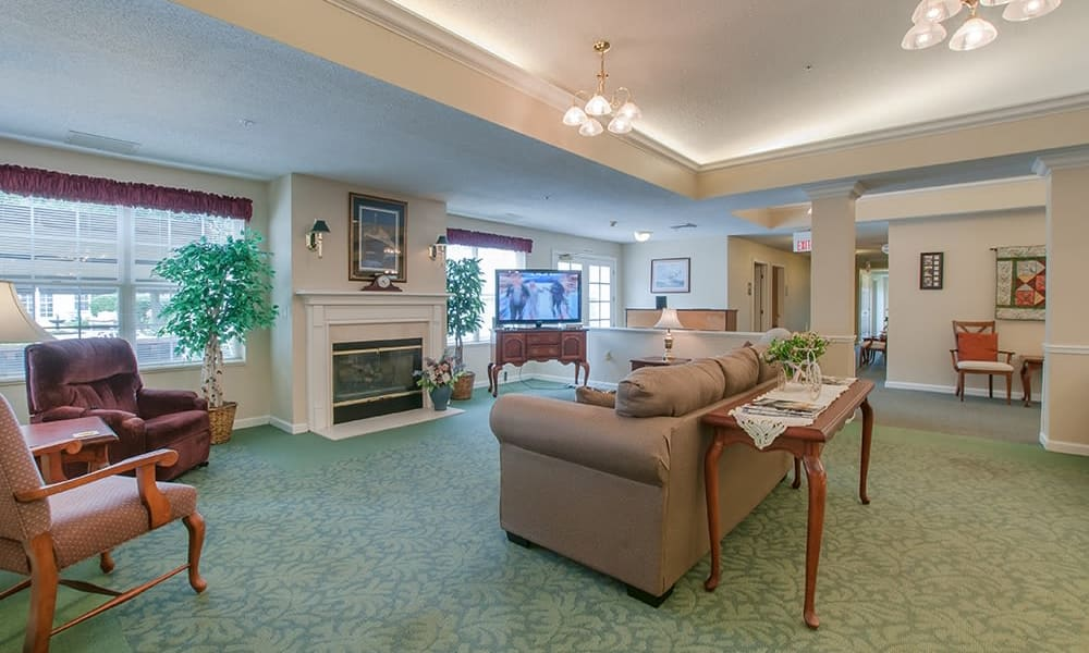 Resident community area with couches and tables at Randall Residence of Newark in Newark, Ohio