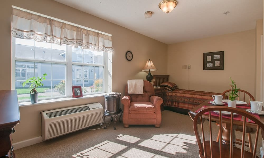 Resident living room in senior living apartment at Randall Residence of Troy in Troy, Ohio