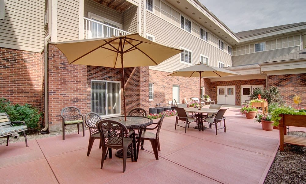 Covered patio seating on porch at Randall Residence of McHenry in McHenry, Illinois