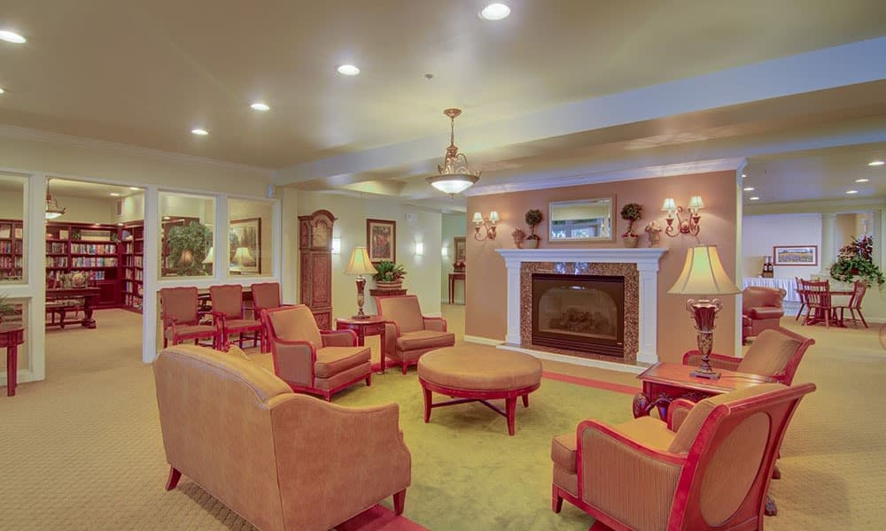 Community living area with fireplace at Randall Residence of McHenry in McHenry, Illinois