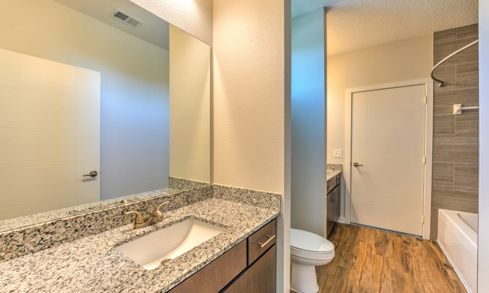 Bathroom with large mirror at Fusion apartments in Jacksonville, Florida