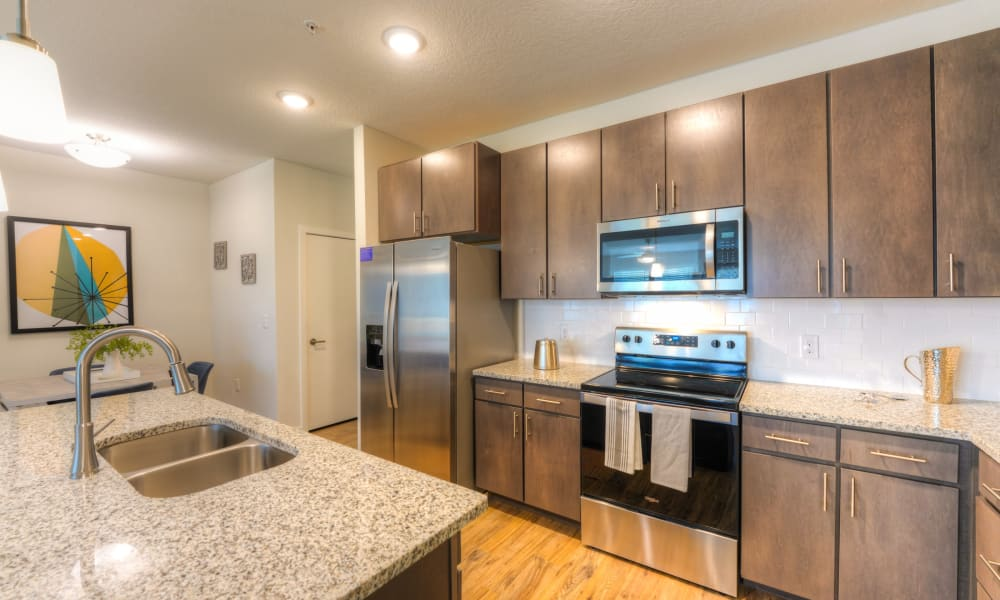 Spacious kitchen featuring breakfast bar seating at Fusion apartments in Jacksonville, Florida