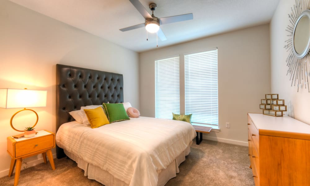Spacious bedroom with large window at Fusion apartments in Jacksonville, Florida