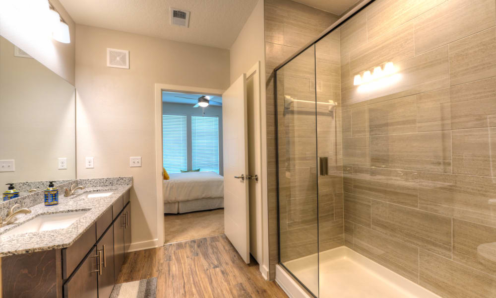 Large bathroom with shower at Fusion apartments in Jacksonville, Florida