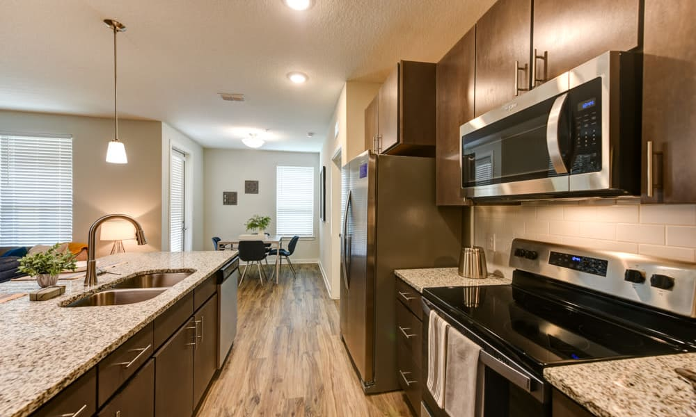 View towards living room from spacious kitchen at Fusion apartments in Jacksonville, Florida