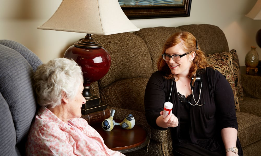 Nurse talking to a resident about medication at Deer Crest Senior Living in Red Wing, Minnesota