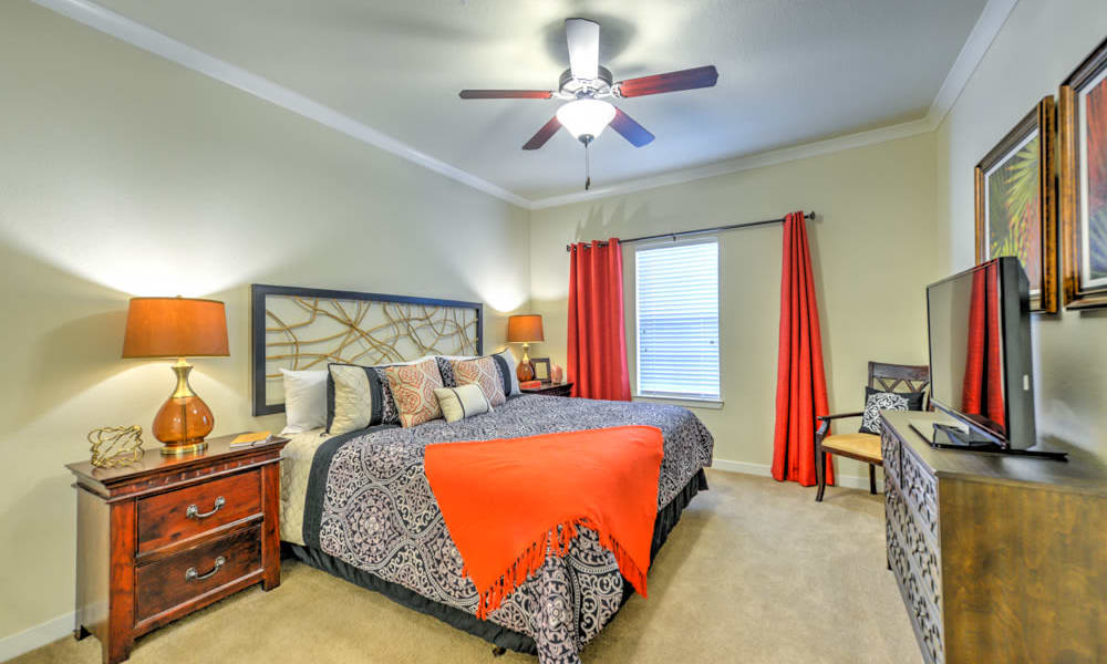 Large bedroom with fan at Hacienda Club in Jacksonville, FL
