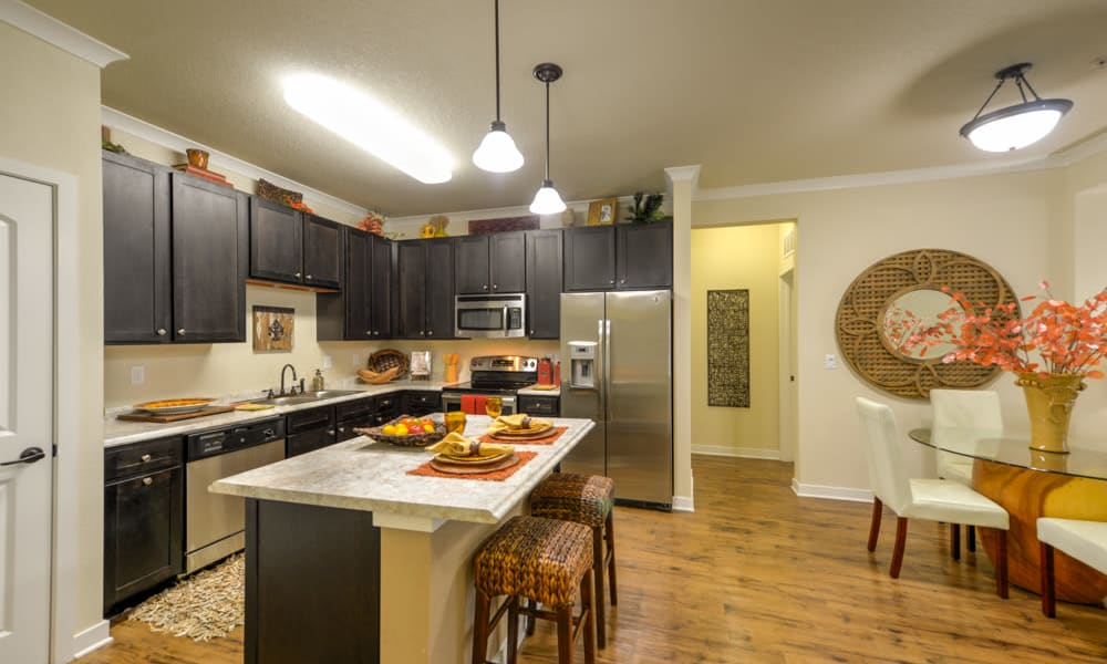 Kitchen with island and lots of counter space at Hacienda Club in Jacksonville, FL