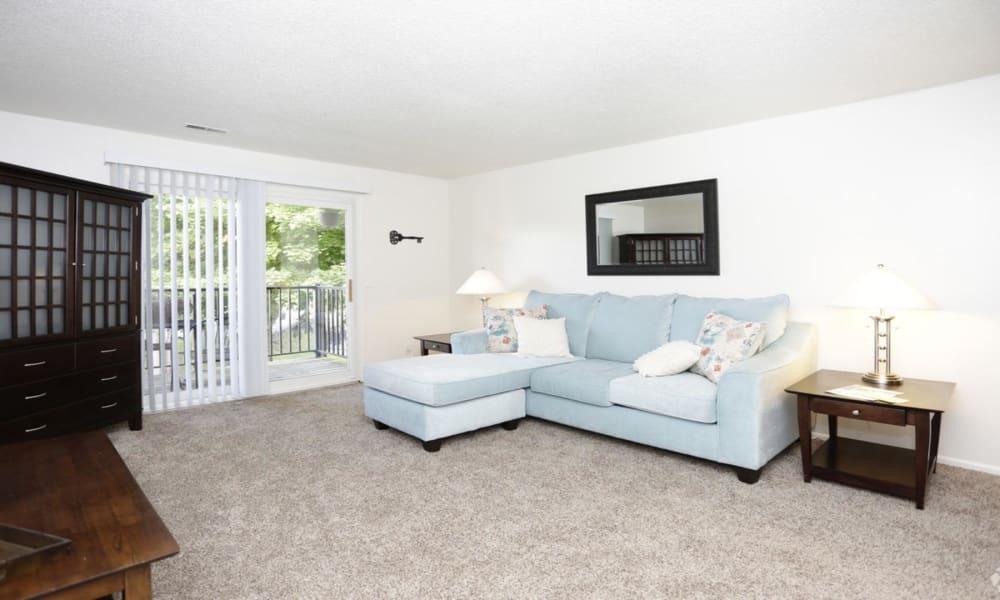 Living room at Arbors of Battle Creek Apartments & Townhomes in Battle Creek, Michigan