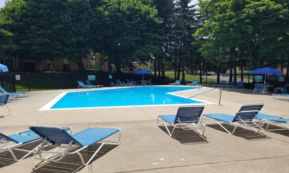 Swimming pool at Arbors of Battle Creek Apartments & Townhomes in Battle Creek, Michigan