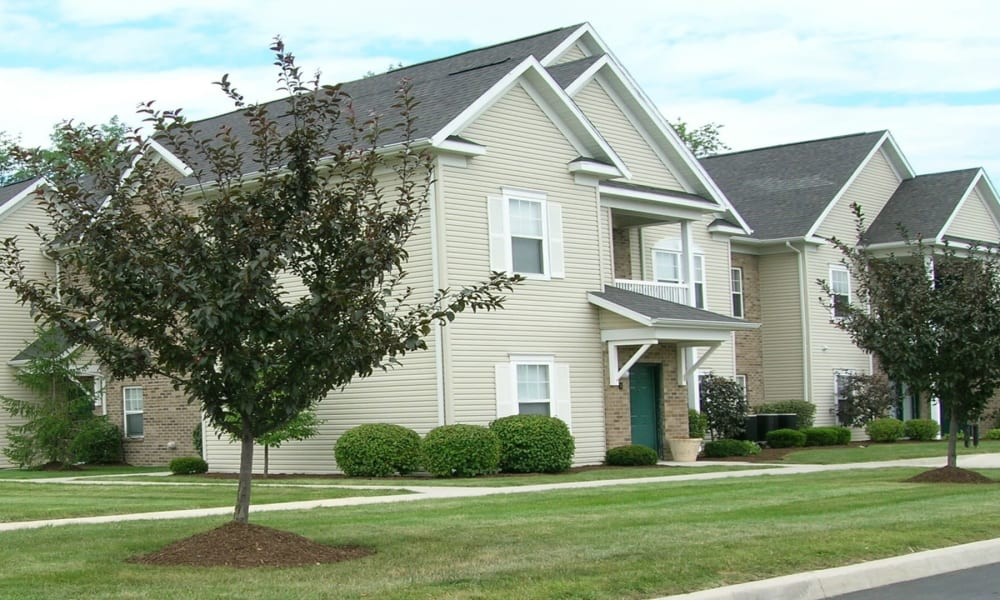 Townhome with green lawn at Avalon at Northbrook Apartments & Townhomes in Fort Wayne, Indiana