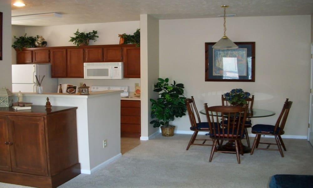 Kitchen and living room at Avalon at Northbrook Apartments & Townhomes in Fort Wayne, Indiana