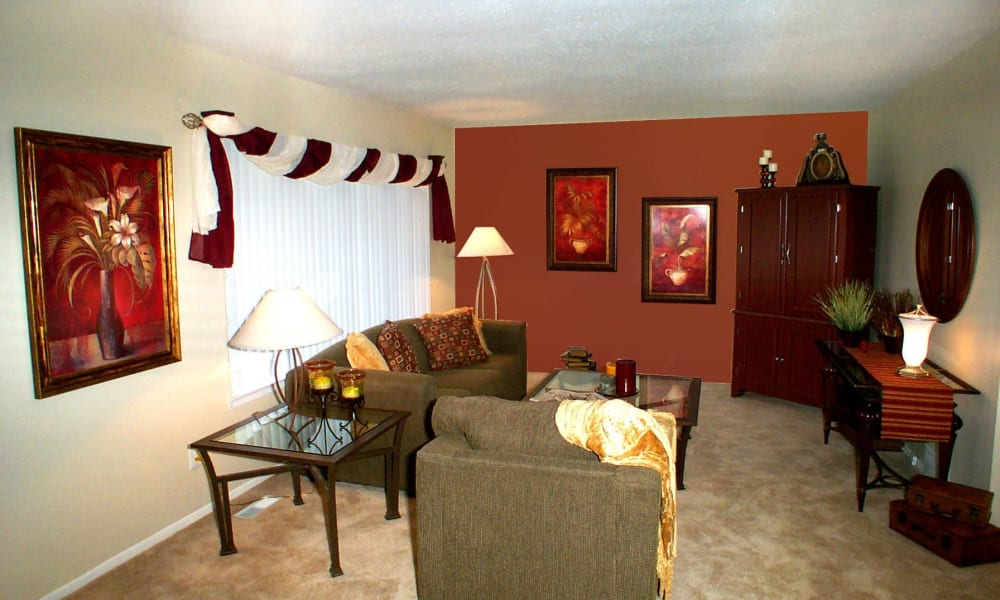 Spacious living room at Briarcliffe Apartments & Townhomes in Lansing, Michigan