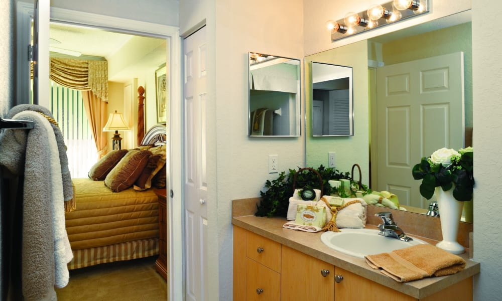 Bedroom and bathroom at Camino Real Apartment Homes in Boca Raton, Florida