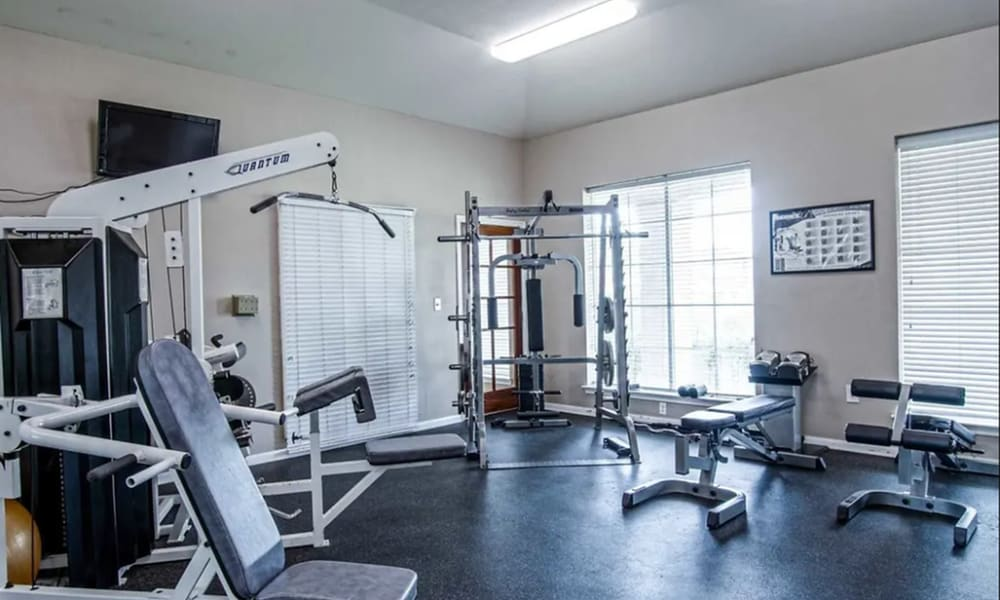 Fitness center at Chateau des Lions Apartment Homes in Lafayette, Louisiana