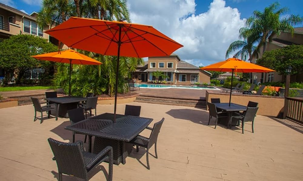 Outdoor patio tables at Tuscany Pointe at Tampa Apartment Homes in Tampa, Florida