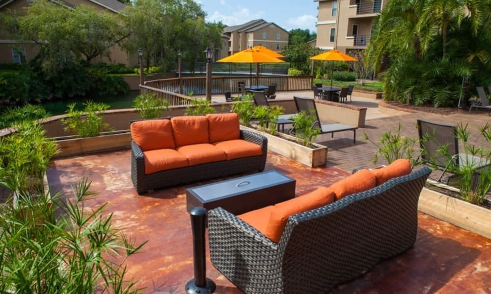 Cozy outdoor seating at Tuscany Pointe at Tampa Apartment Homes in Tampa, Florida