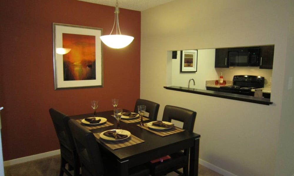 Dining table in model apartment home at Tuscany Pointe at Tampa Apartment Homes in Tampa, Florida