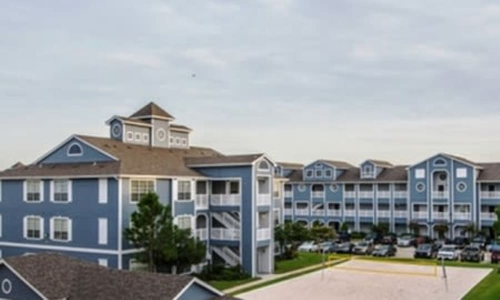 Sand volleyball court at Villa du Lac Apartment Homes in Slidell, Louisiana