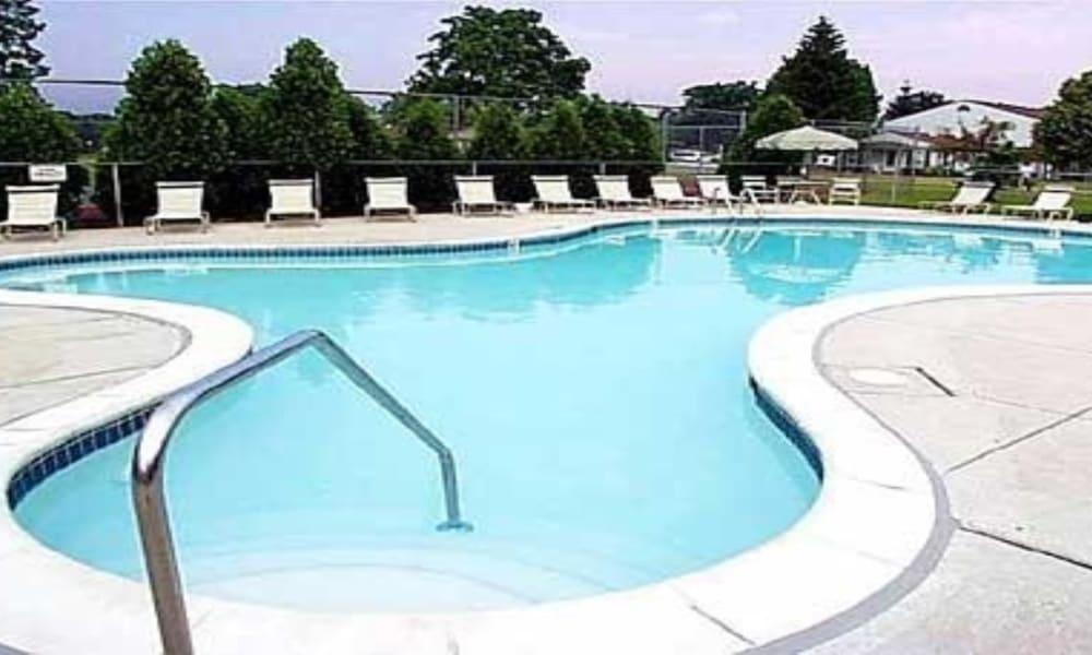 Sparkling pool at Pavilion Court Apartment Homes in Novi, Michigan