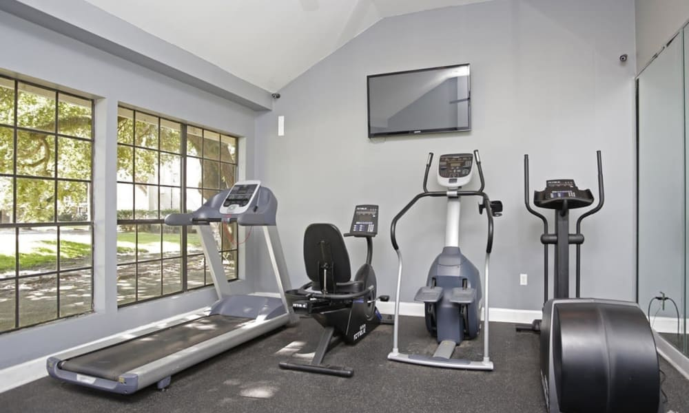 Fitness center at Peppertree Apartment Homes in Lafayette, Louisiana