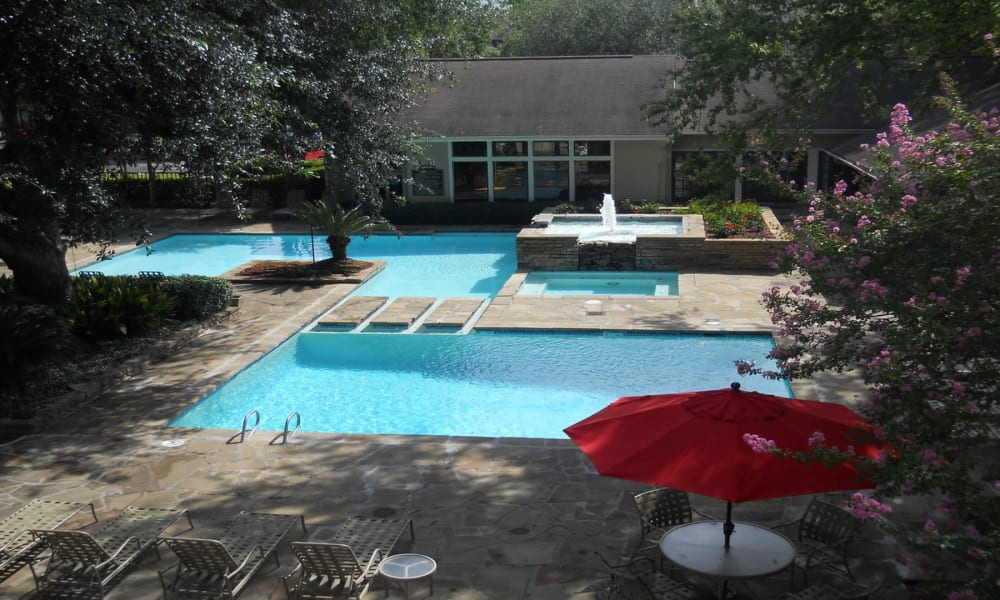 Sparkling pool at Peppertree Apartment Homes in Lafayette, Louisiana