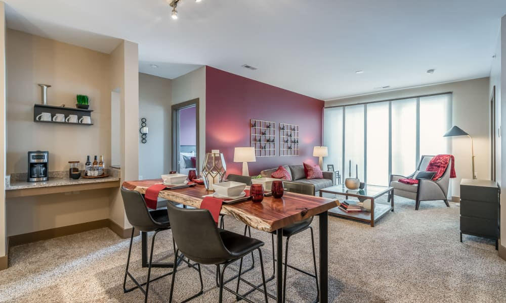Carpeted living room at Latitude at Deerfield Crossing in Mason, Ohio