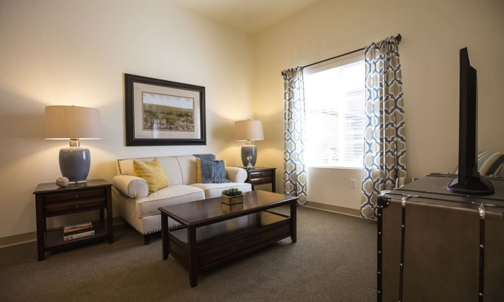 A living room with natural lighting at The Pointe at Summit Hills in Bakersfield, California.