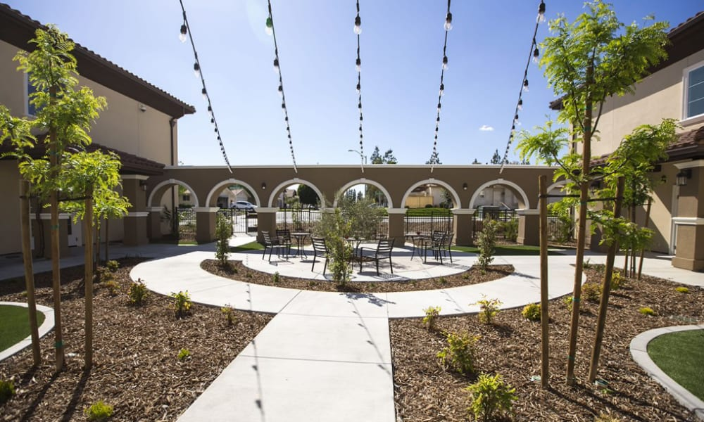 Courtyard with light strings at The Pointe at Summit Hills in Bakersfield, California.