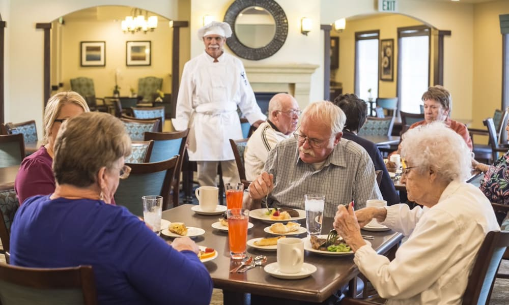 Residents enjoying a meal at The Pointe at Summit Hills in Bakersfield, California.
