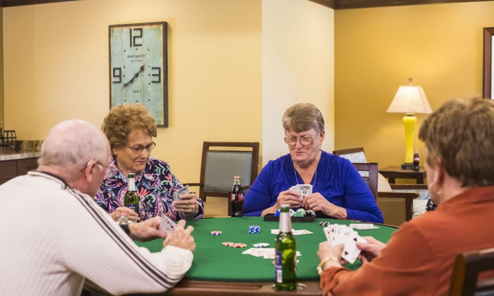 Residents playing a card game at The Pointe at Summit Hills in Bakersfield, California.