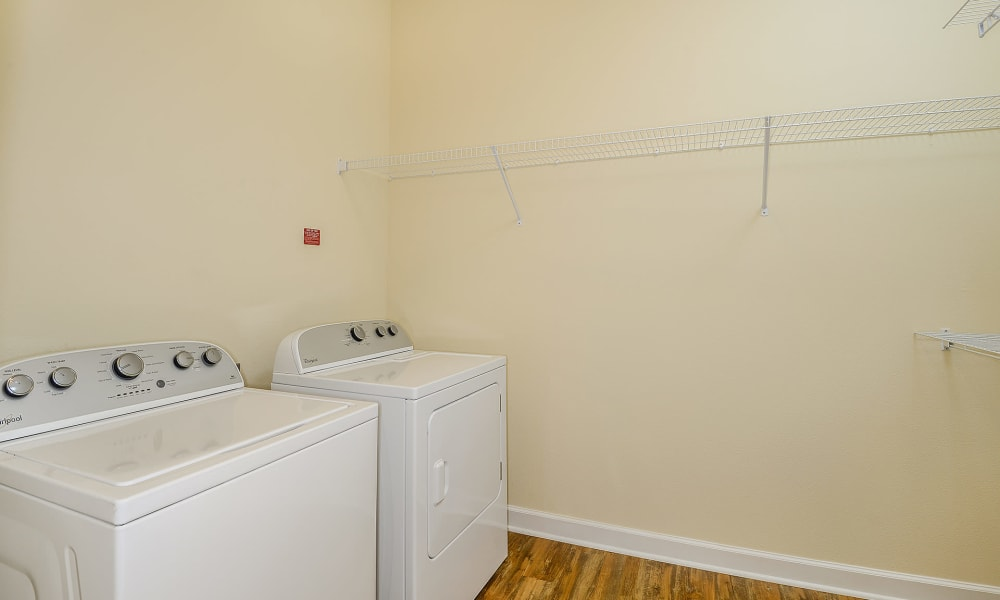 Laundry room area with storage area at Palm Bay Club in Jacksonville, Florida