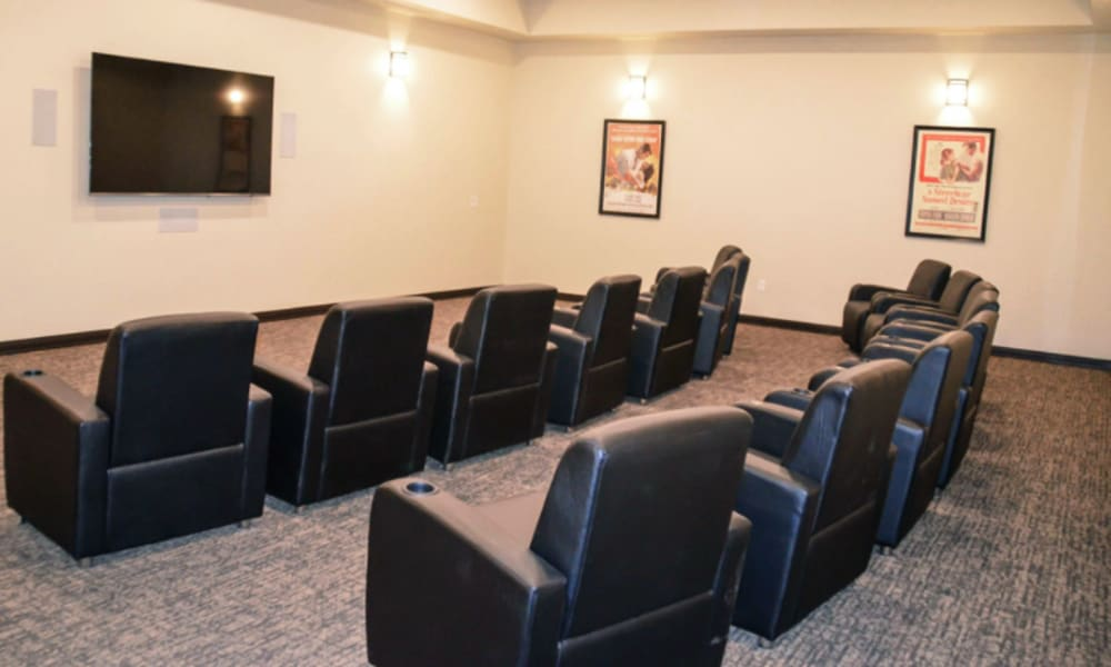 Mini theater with 20 recliner chairs opposing a tv at Aspen Valley Senior Living in Boise, Idaho