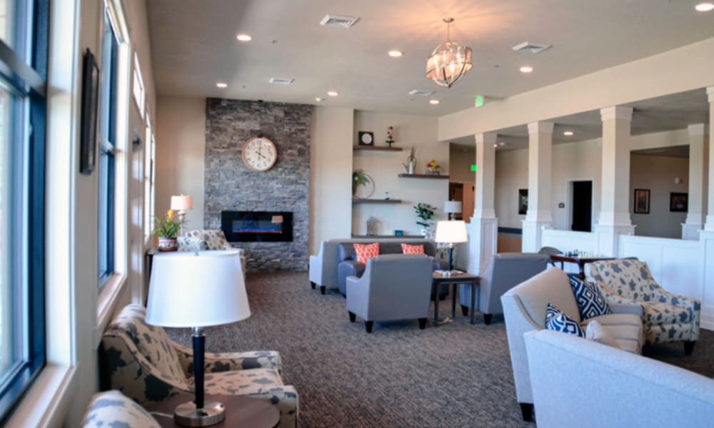 Decorated lounge area with a muted blue color scheme at Aspen Valley Senior Living in Boise, Idaho