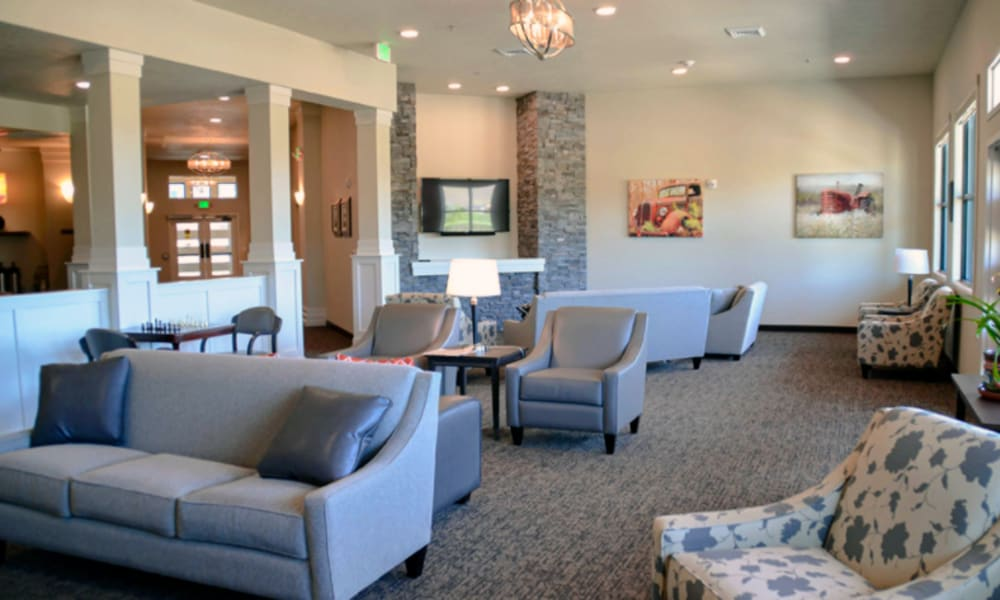Lounge room with several spots to sit and large open windows at Aspen Valley Senior Living in Boise, Idaho