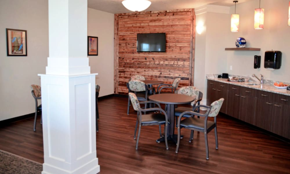 Cafe dining area with a serving bar and tv at Aspen Valley Senior Living in Boise, Idaho