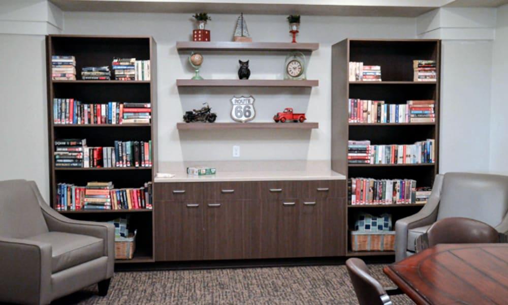 Reading corner with 2 stocked bookshelves at Aspen Valley Senior Living in Boise, Idaho