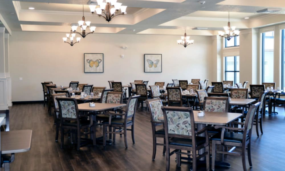dining hall with dark hard wood flooring at Aspen Valley Senior Living in Boise, Idaho