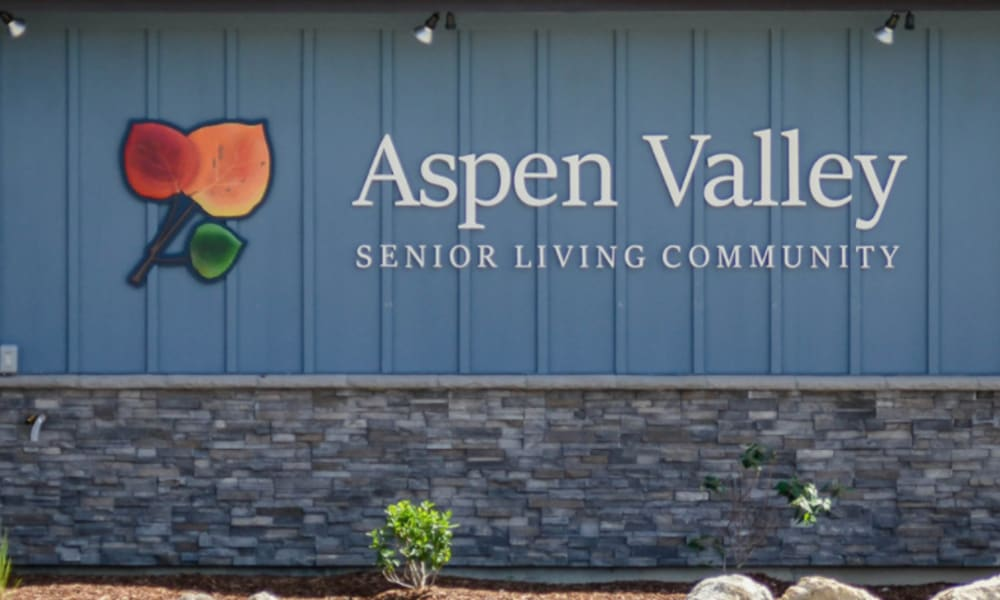 multicolored leaf Logo and signage outside of Aspen Valley Senior Living in Boise, Idaho