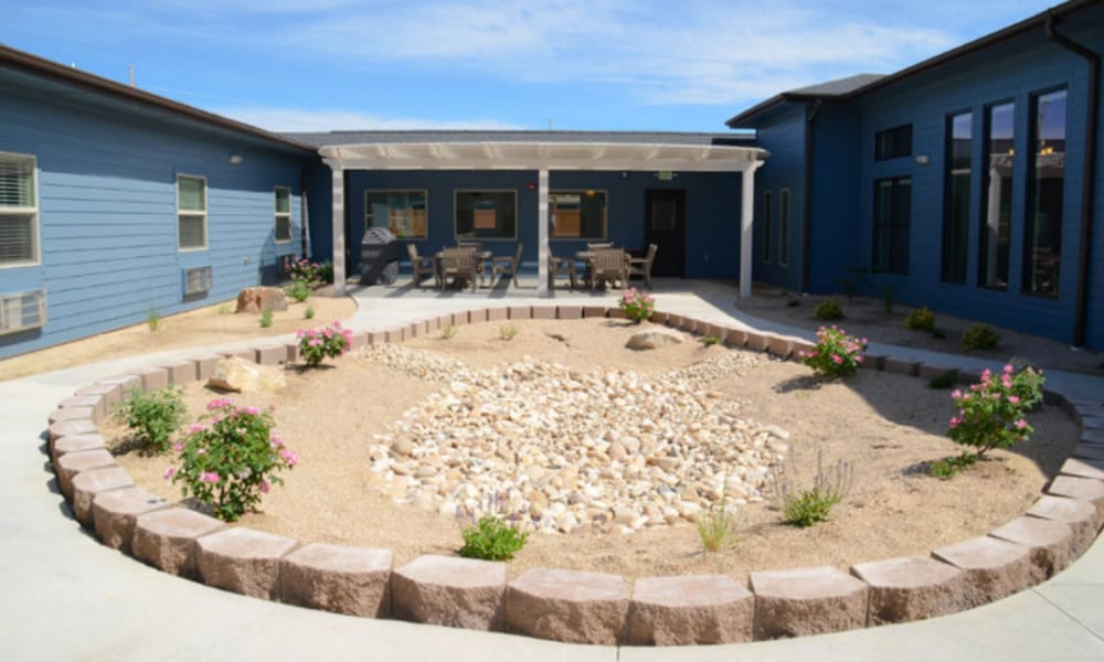 Circular walking path with a rock garden at its center at Aspen Valley Senior Living in Boise, Idaho