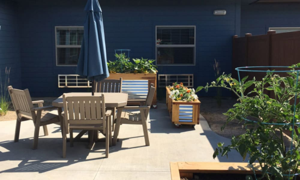 Outdoor patio with seating at Aspen Valley Senior Living in Boise, Idaho