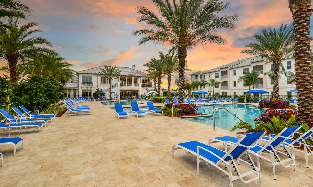 Gorgeous twilight sky above the swimming pool area at Palm Bay Club in Jacksonville, Florida