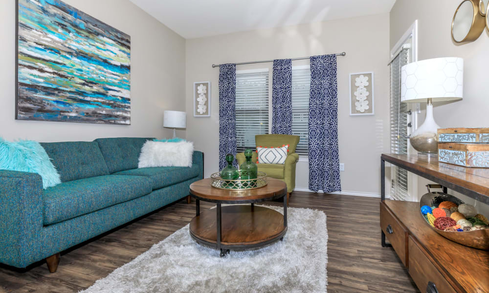 Living room with wood style flooring at APEX in San Antonio, Texas