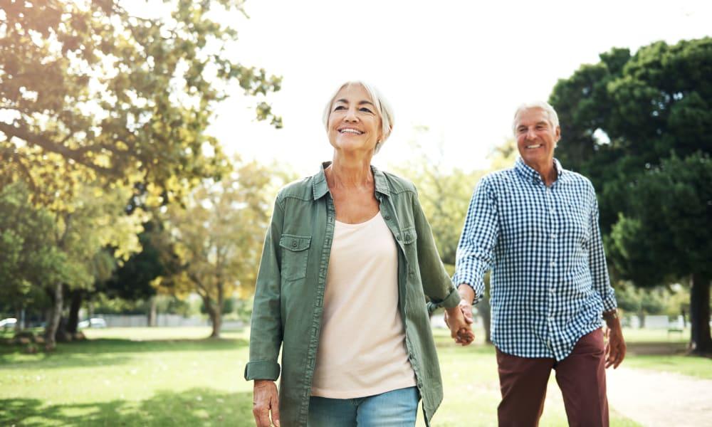 Couple walking through a park near Mount Carmel Apartments in Mount Carmel, Pennsylvania