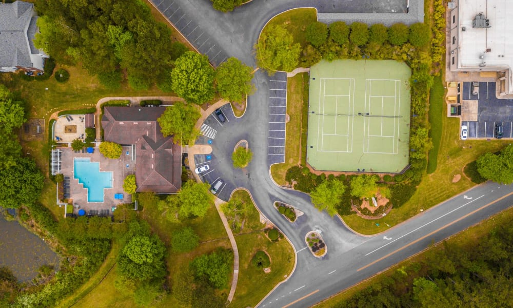 Aerial View of the Swimming Pool & Tennis Courts at Manchester at Wesleyan Apartment Homes in Macon, Georgia