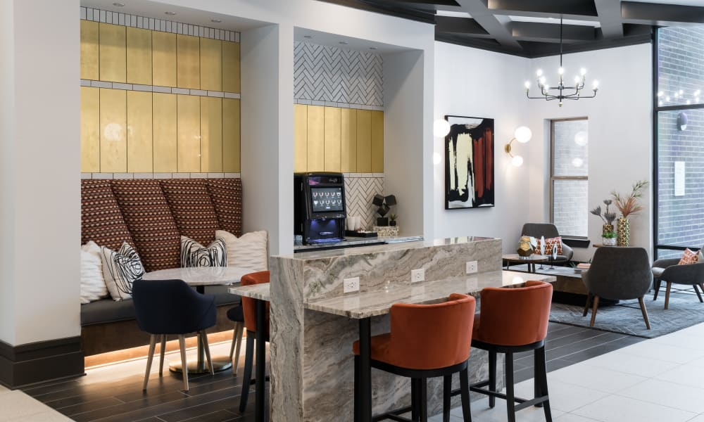 Spend time with friends and family in the common area at The ReVe in Garland, Texas