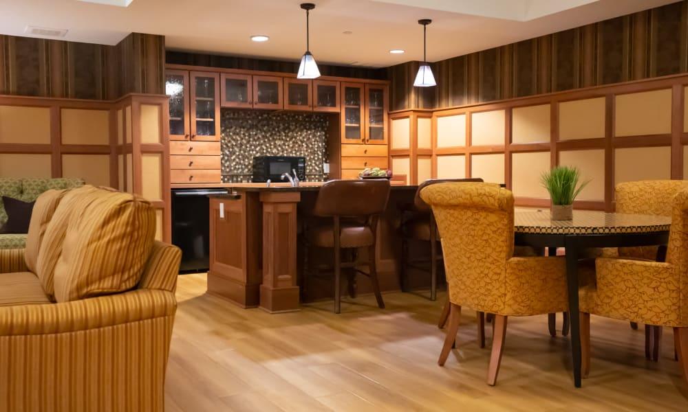 Cafe with a serving bar and hardwood floors at York Gardens in Edina, Minnesota