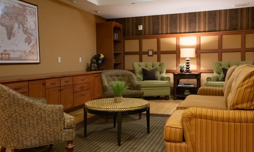 Coffee table surrounded by plush seating at York Gardens in Edina, Minnesota
