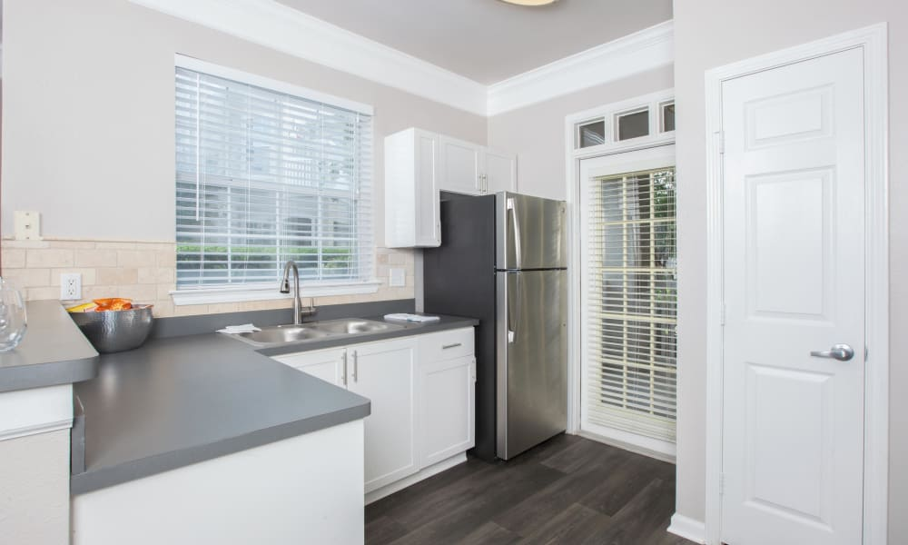 Kitchen with wood-style flooring at The View at Encino Commons in San Antonio, Texas