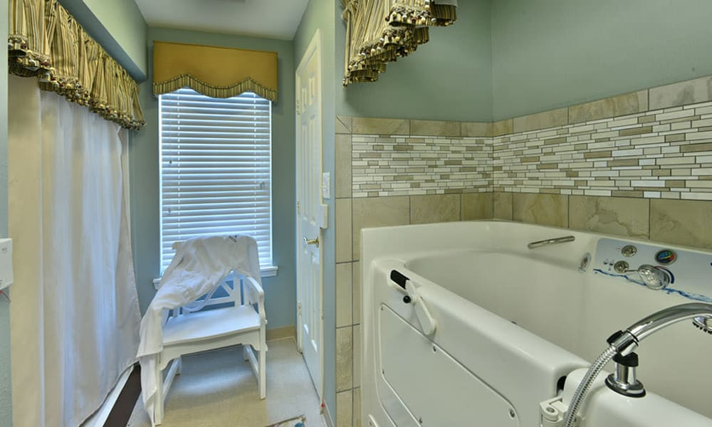 Assisted Bathing at  at The Arbors at Dogwood Pointe Senior Living in Milan, Tennessee
